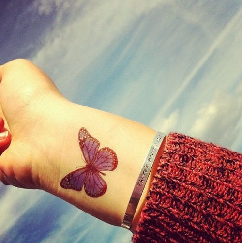 Blue Butterfly on Wrist Tattoo