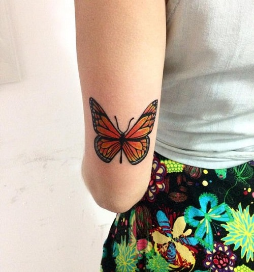 butterfly tattoo near elbow