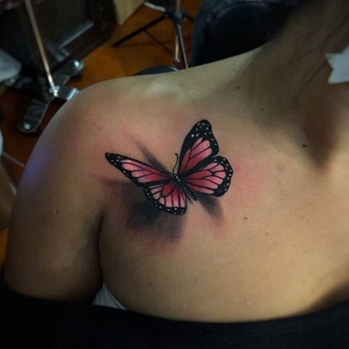 Pink Butterfly on Chest Tattoo