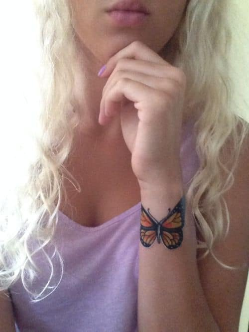 Small Butterfly on Arm Tattoo