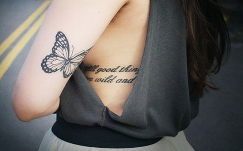 Small Butterfly on Upper Back Arm Tattoo