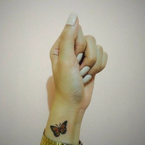 Small Butterfly Wrist Tattoo