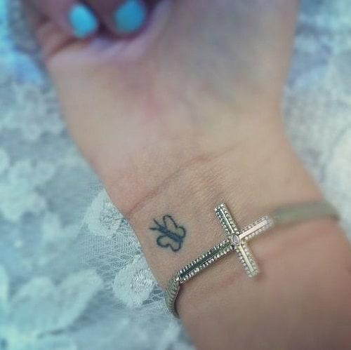 Tiniest Butterfly on Wrist Tattoo