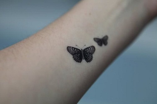 Two Small, Detailed Butterfly Tattoos on Arm