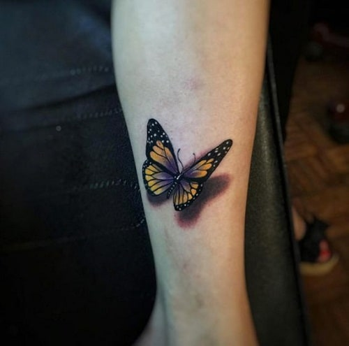 Yellow and Black with a Touch of Violet Butterfly Arm Tattoo