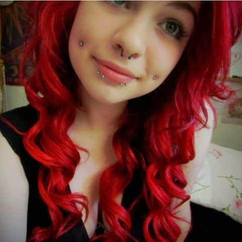 Septum Nose And Cheek Piercing Picture