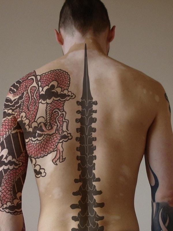 men spine tattoo