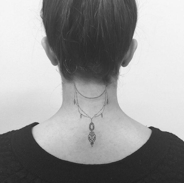 Dangling Back Neck Tattoo by Jon Boy