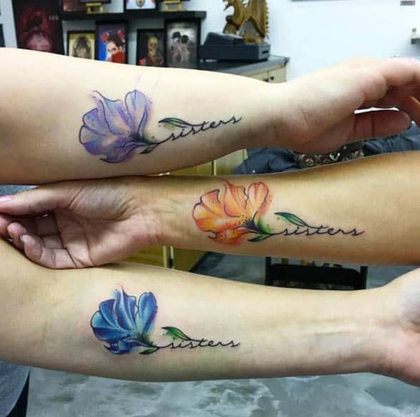 Floral Watercolor Sister Tattoos by Jordan Ashley
