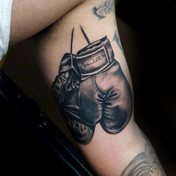 Awesome Memorial Boxing Gloves Tattoo On Guys Inner Arm
