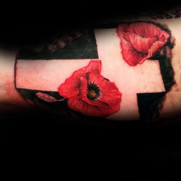 Negative Space Cross With Red Poppy Flowers Memorial Arm Tattoos For Men