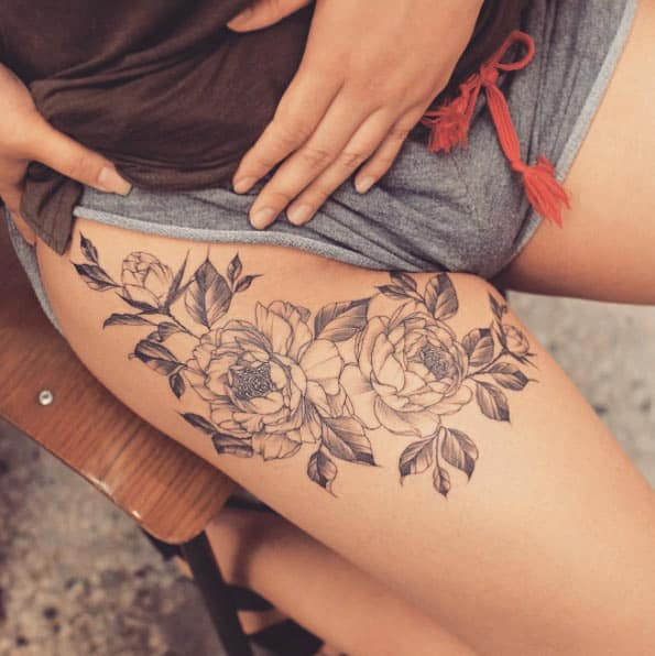 Peony tattoo on thigh by Tattooist Grain