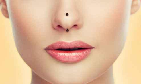 vertical tip nose piercings