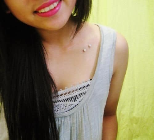 Girl With Surface Barbell Collar Bone Piercing