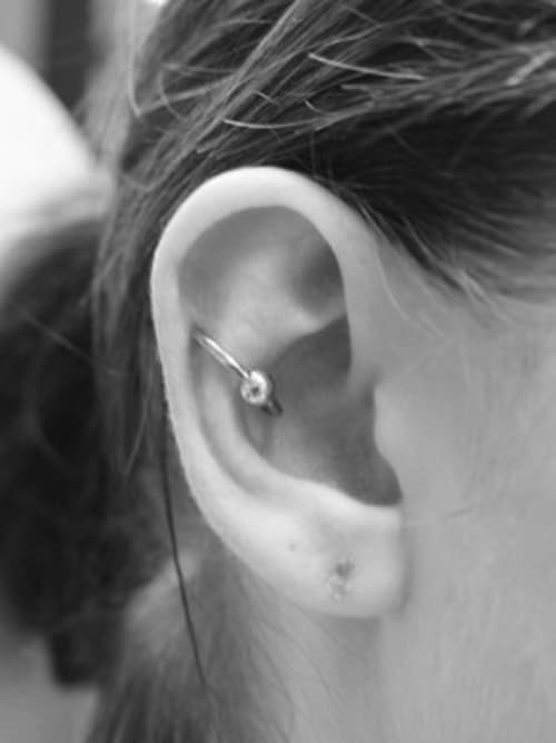 Conch to Helix Orbital Piercing