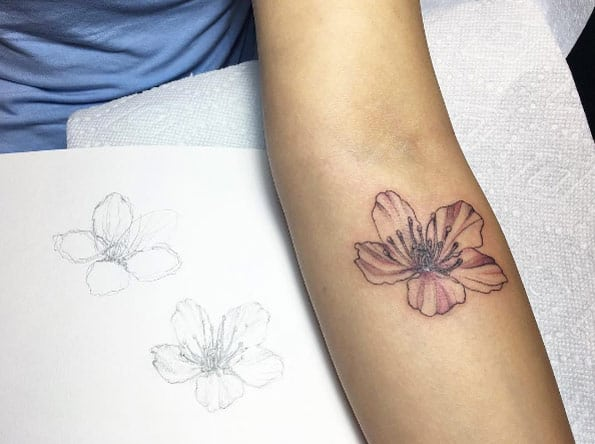 Single cherry blossom on forearm by Barythaya