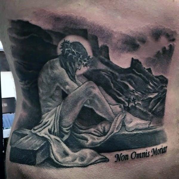 christian-themed-tattoos-on-man