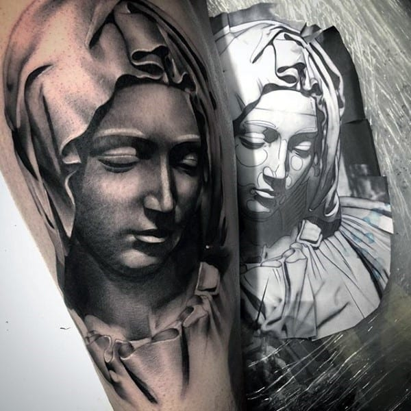 guy-with-christian-symbol-tattoo-of-mother-mary