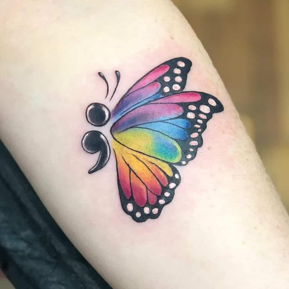 butterfly semicolon tattoo on leg