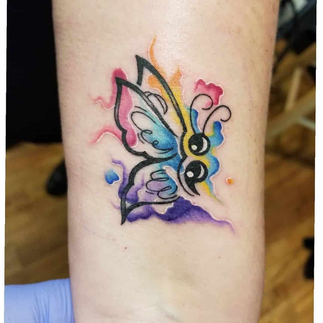 butterfly semicolon tattoo on arm