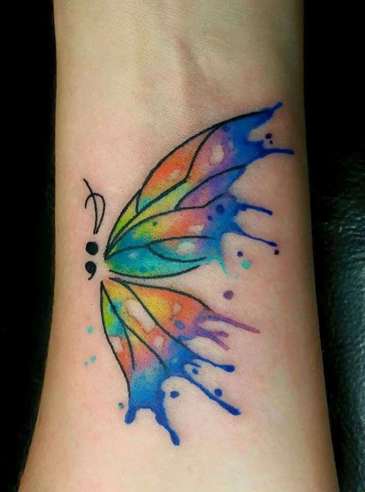 butterfly semicolon tattoo on wrist