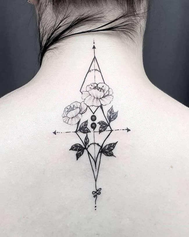 flower semicolon tattoo on back