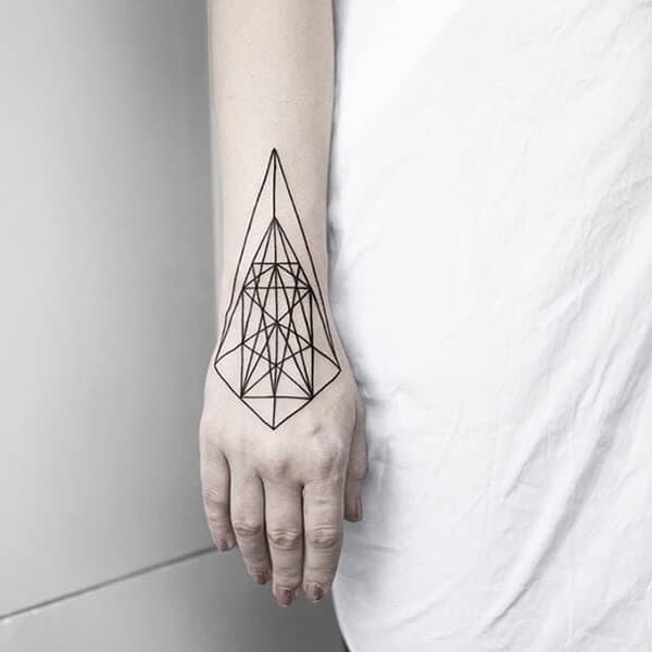 geometric hand tattoo