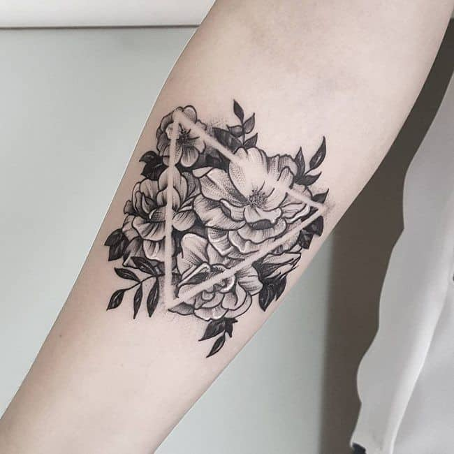 geometric hibiscus tattoo on arm
