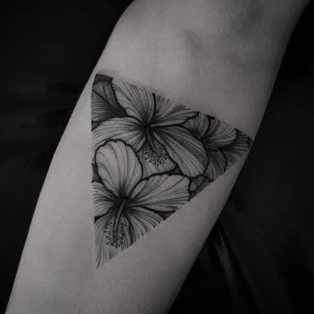 geometric hibiscus tattoo