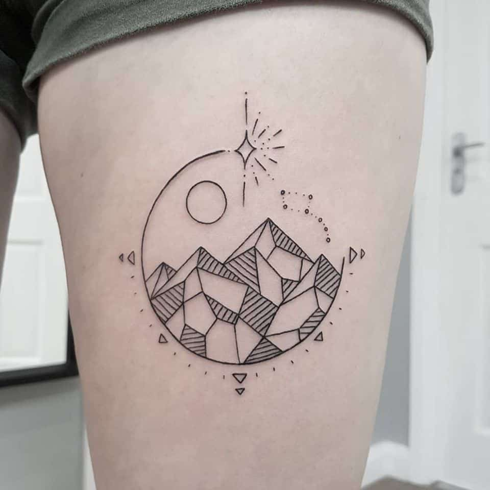 geometric mountain tattoo on thigh