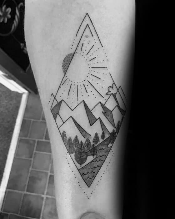 geometric mountain tattoo on arm