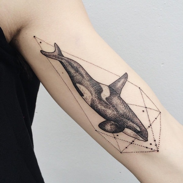 geometric sea creature tattoo on arm