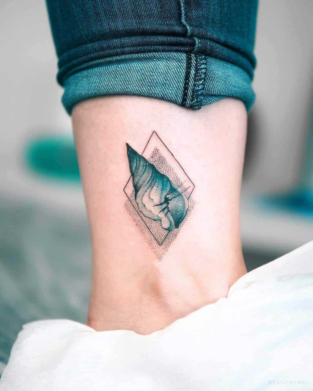 geometric sea creature tattoo on ankle