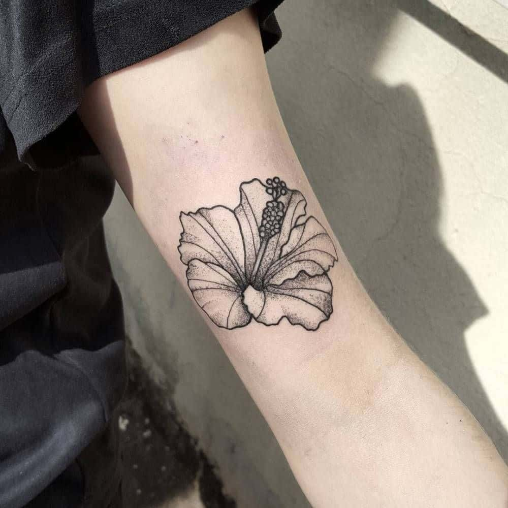 hibiscus arm tattoo