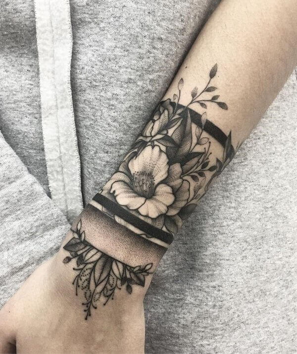 hibiscus tattoo on arm