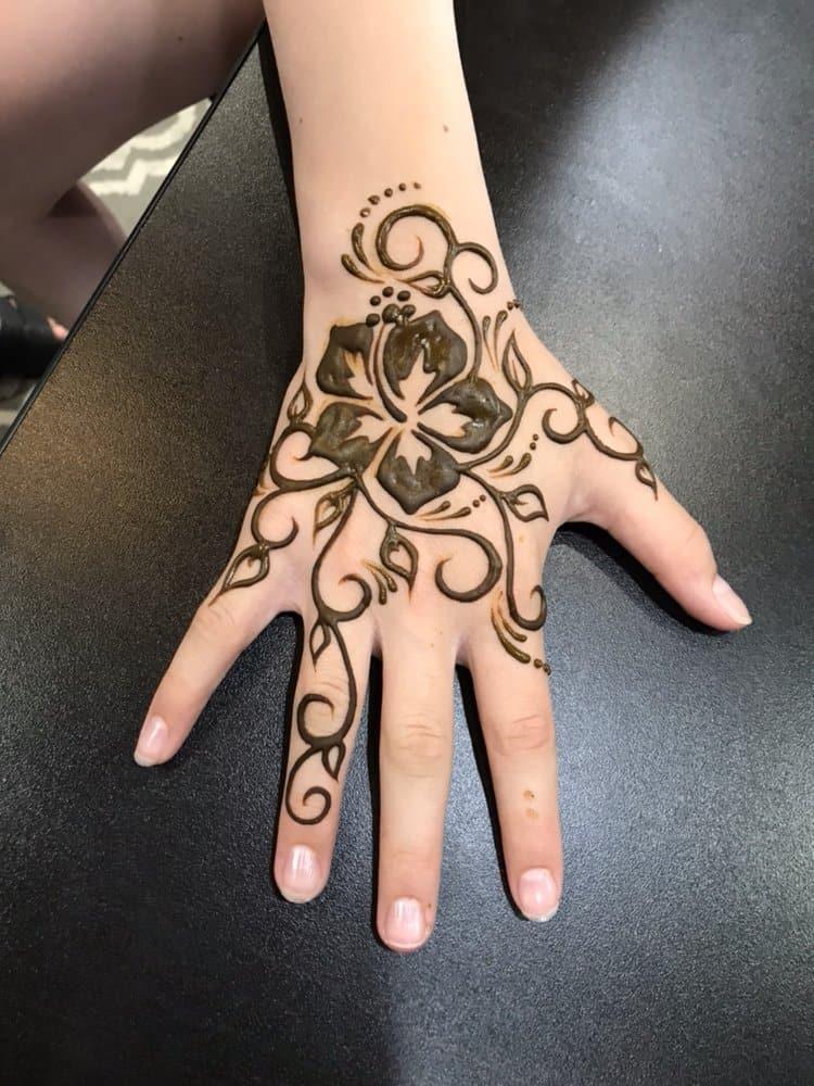 hibiscus hand tattoo