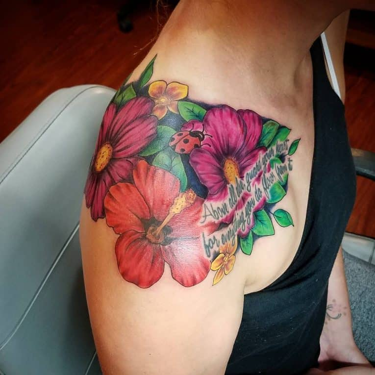 hibiscus shoulder tattoo