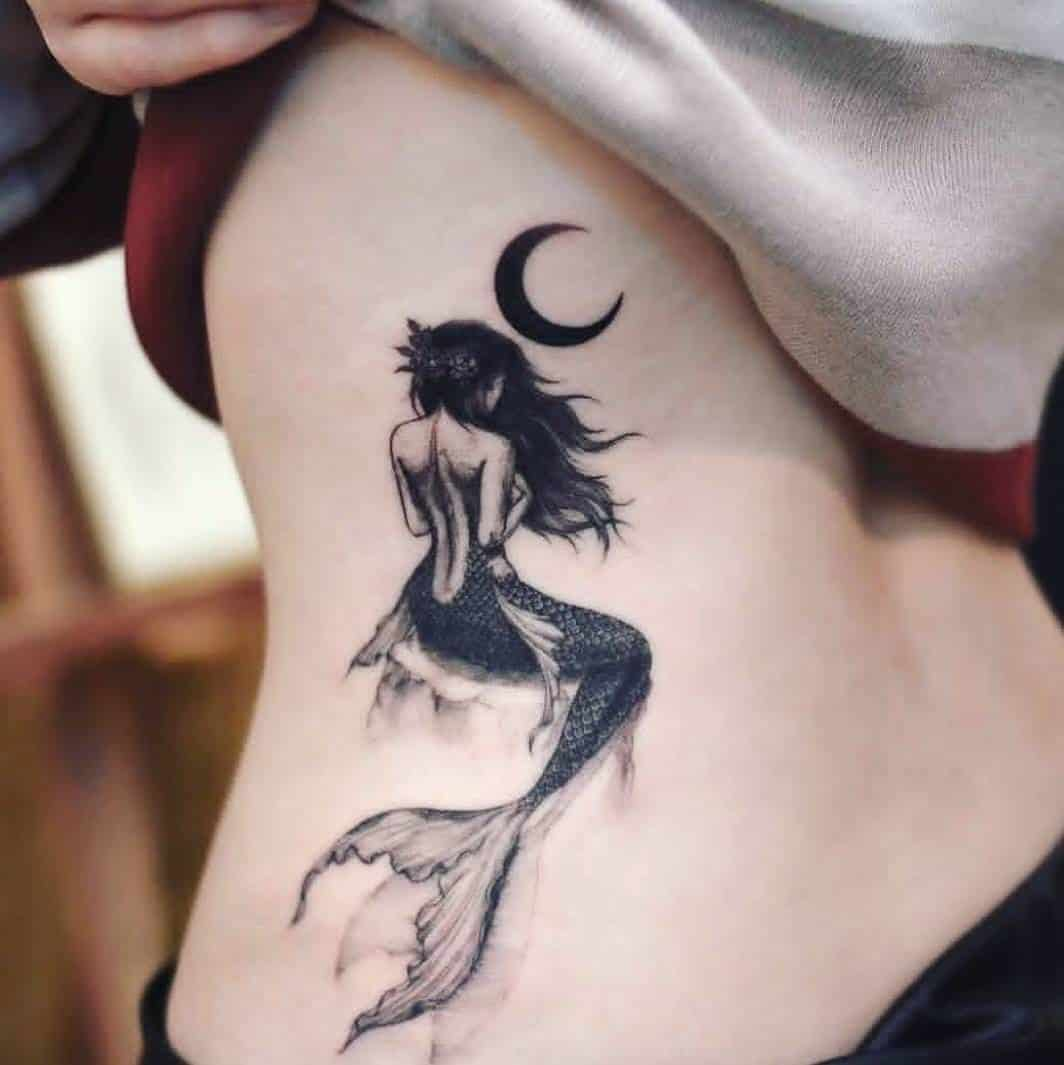 mermaid tattoo on back