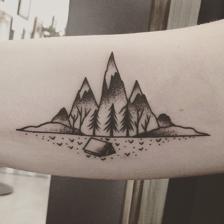 mountain tattoo on arm