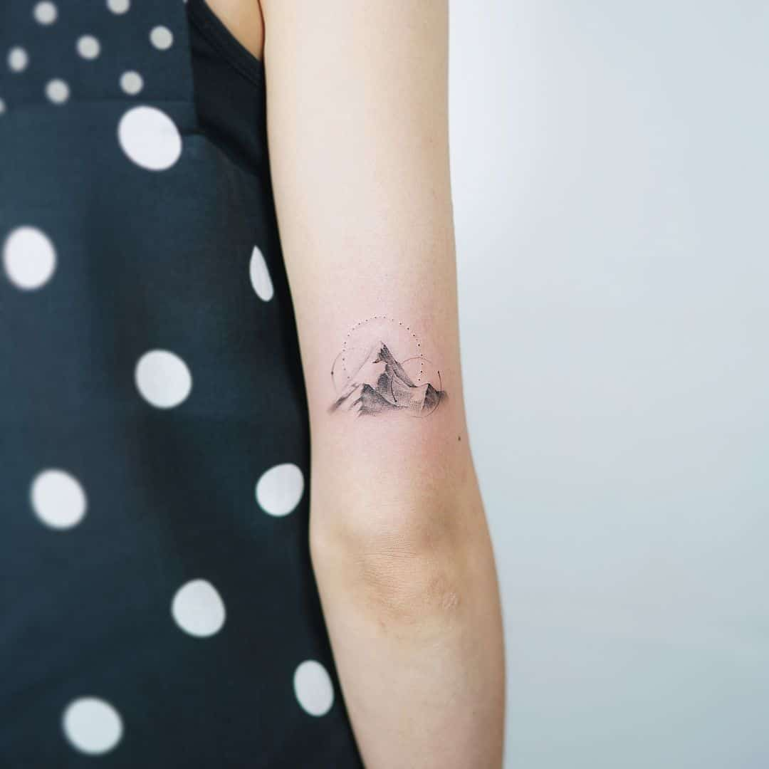 mountain elbow tattoo
