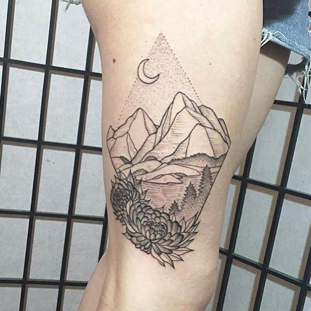 mountain tattoo on thigh