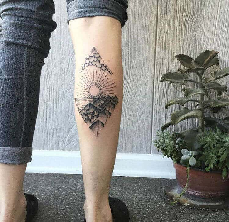 mountain tattoo on leg