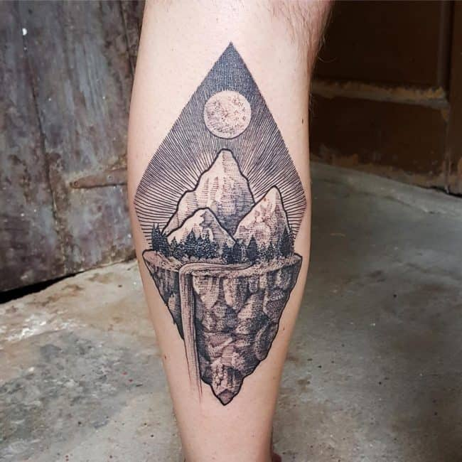 mountain on leg tattoo