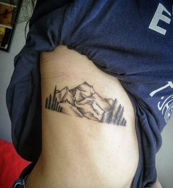 mountain tattoo on rib