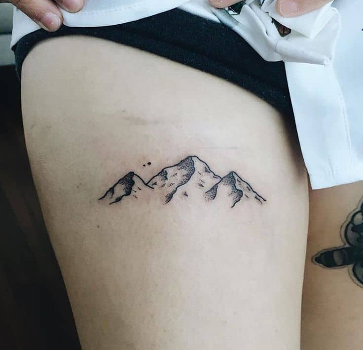 mountain thigh tattoo