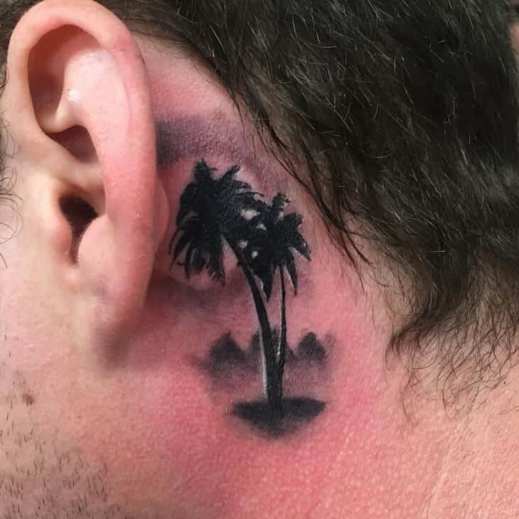 palm tree ear tattoo