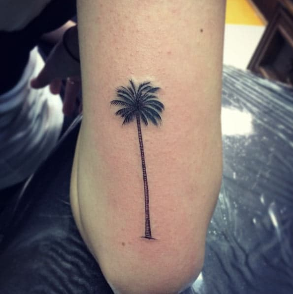 palm tree elbow tattoo