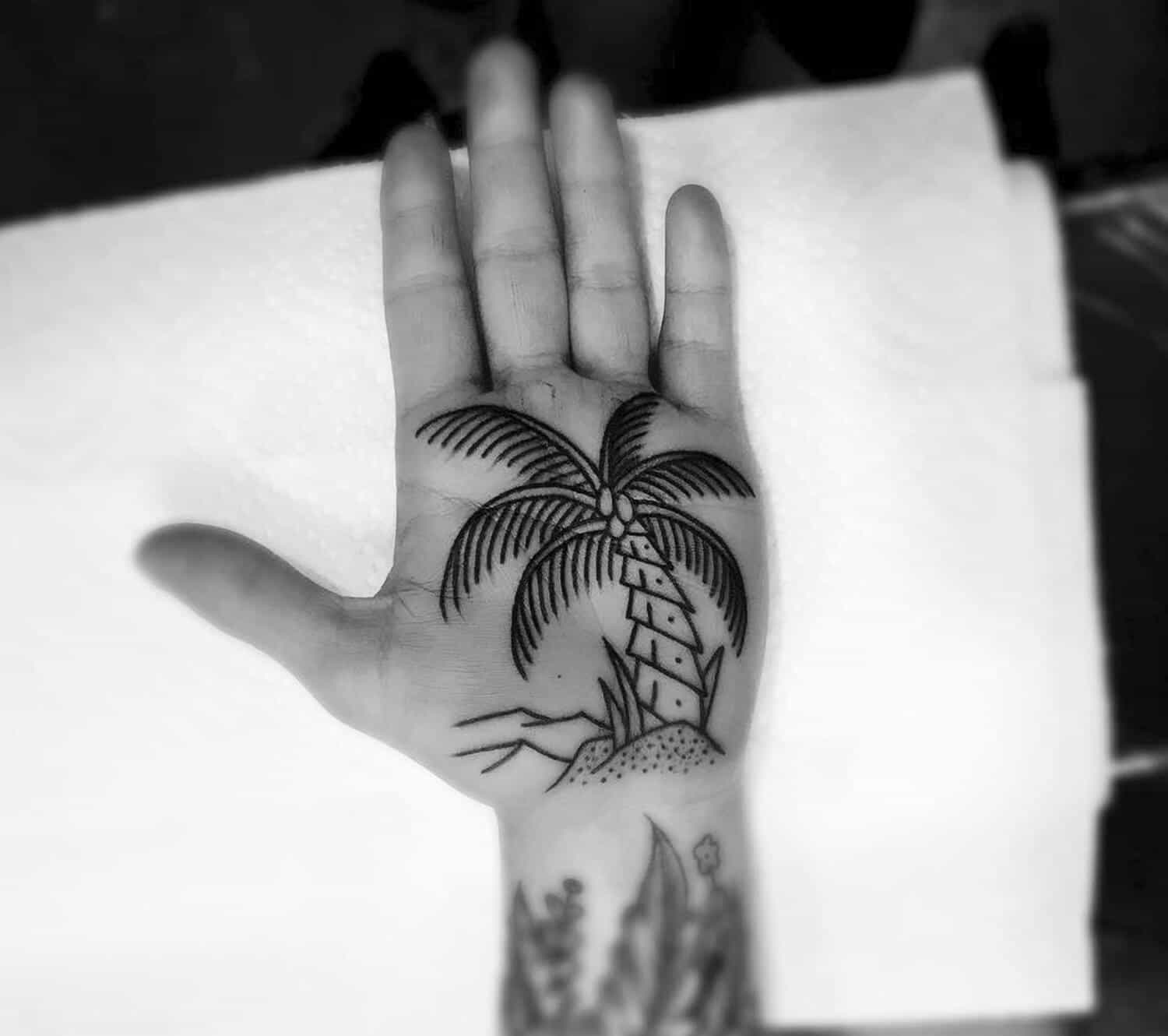 palm tree hand tattoo