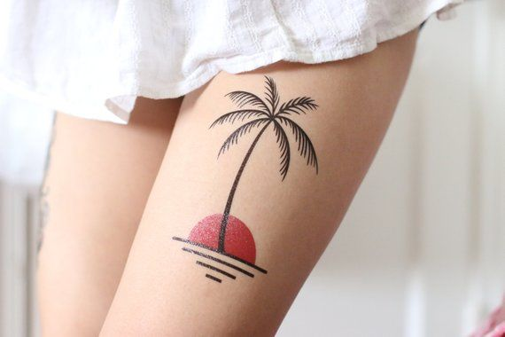 palm tree thigh tattoo