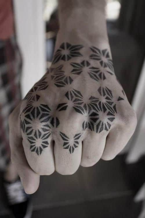 pointillism tattoo on hand